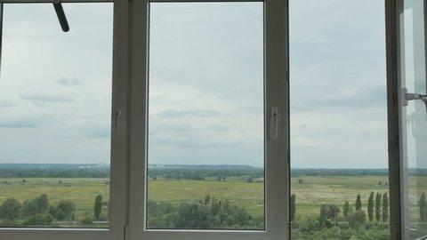 Modern plastic window with amazing landscape outside