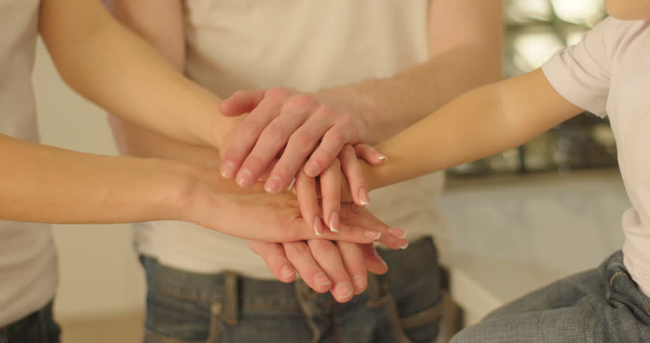 The close-up view of the family hands putting them on each other. The symbol of team unity. #29538652