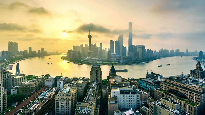 """4k (4096x2304) time-lapse: Shanghai skyline at sunrise.Aerial view of high-rise buildings with Huangpu River in Shanghai, China.- Original Size 8k. - >>> Please search similar: """" ShanghaiSkyline """" ."""