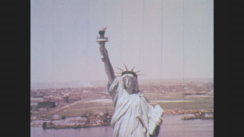 1960s: Statue of Liberty stands on Liberty Island in New York Harbor. | Shutterstock HD Video #29565346