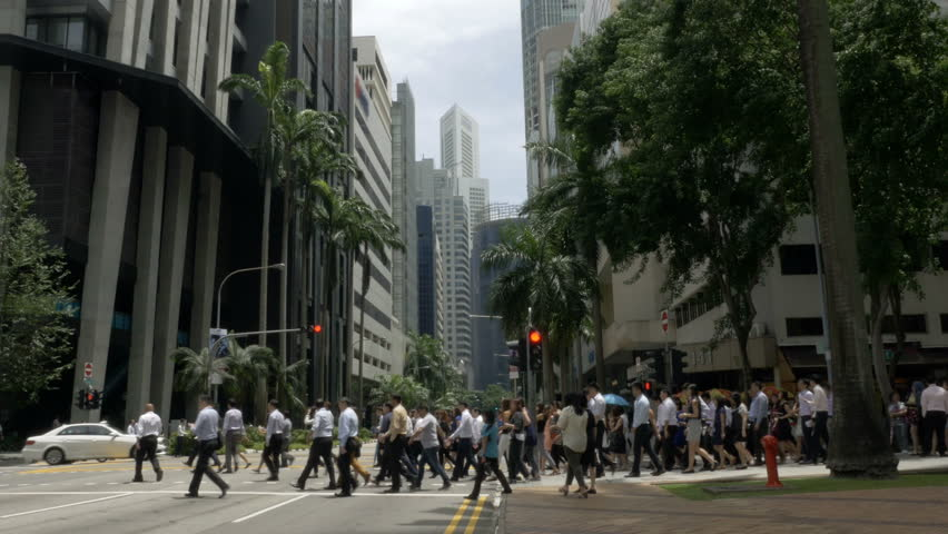 Crowd of business people crossing the street in downtown Singapore, Asia | Shutterstock HD Video #29576395
