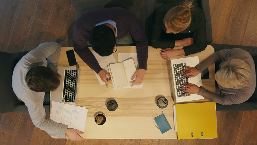 Group of creative people discussing, preparing important contract | Shutterstock HD Video #29583334