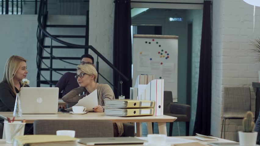 Two women having coffee break together in office | Shutterstock HD Video #29584591