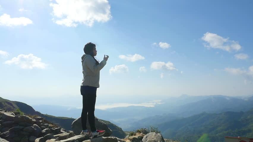 Asian woman hiker at mountain peak | Shutterstock HD Video #29587873