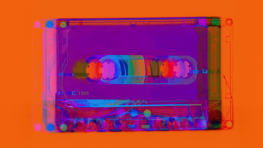 changing audio tape cassettes turn through 360 degrees. all logos removed from the tapes