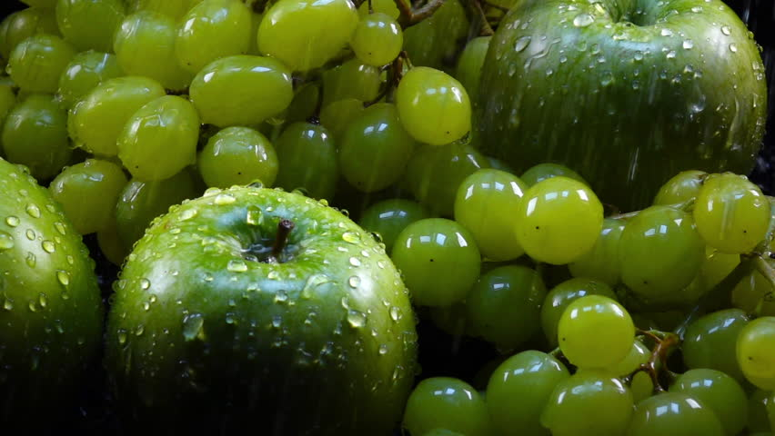 Amazing shower for fresh green apples and grapes in bunches, laying in shallow water in back-light. Excellent slow motion for vibrant intro in full HD. Shooting with high-speed, 240fps, camera.  | Shutterstock HD Video #29597395