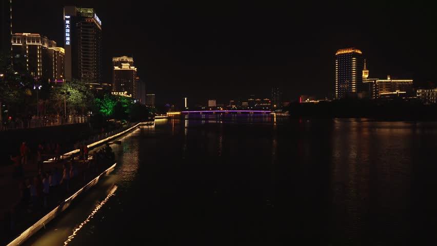 Sanya, China - April 03, 2017: Beautiful night illumination on the Sanya river embankment time lapse stock footage video