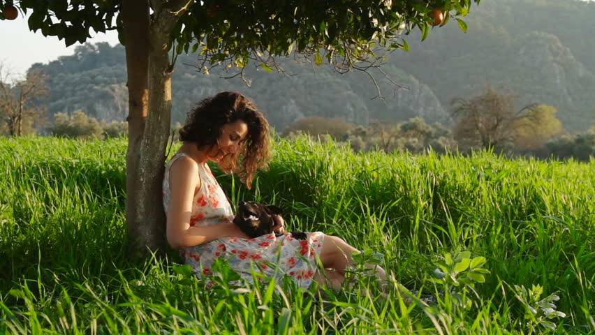 Young Brunette Woman Relaxing Reading Drinking under Orange Tree and Grass | Shutterstock HD Video #29622745