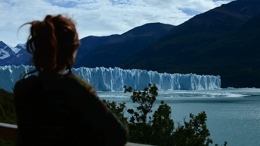 A woman looks the Perito Moreno Glacier