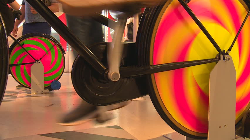 Legs on colorful static pedal bicycle generating electricity. Handheld closeup shot | Shutterstock HD Video #29655907