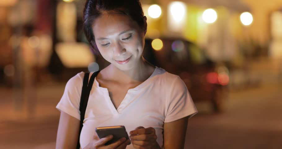 Woman using mobile phone in city at night   Shutterstock HD Video #29667331