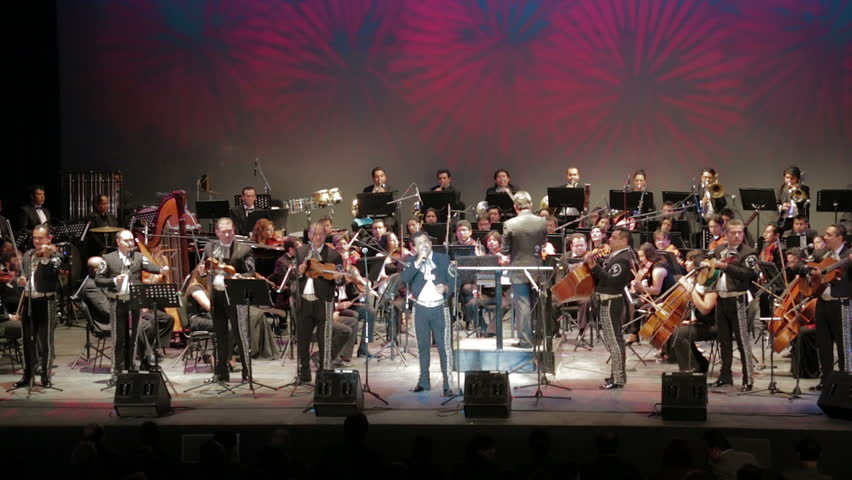GUANAJUATO, MEXICO - CIRCA OCTOBER 2012: The Puebla symphonic orchestra playing together with a mariachi band on stage during the Cervantino festival circa October 2012 in Guanajuato, Mexico.