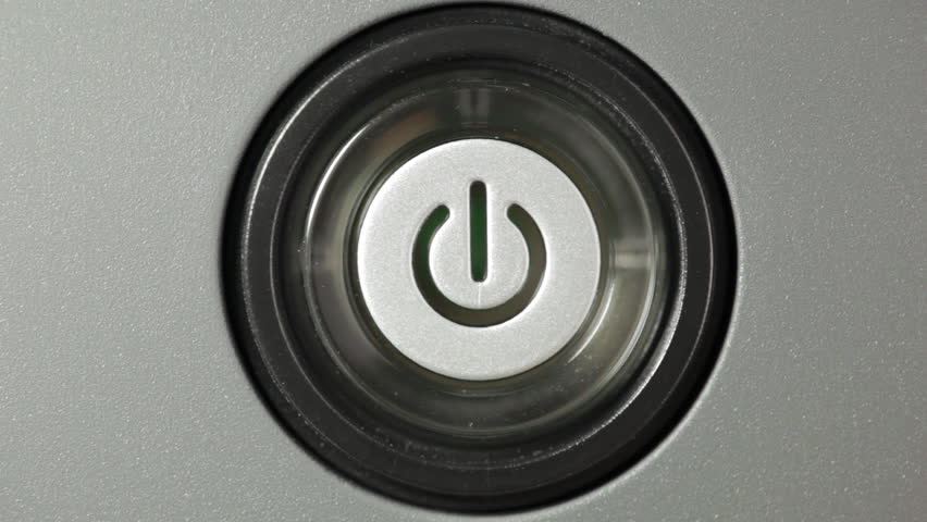 Press power button. Male index finger turning on a power button.