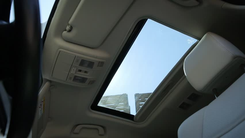 Interior view of car sunroof opening, tan interior. | Shutterstock HD Video #29688352
