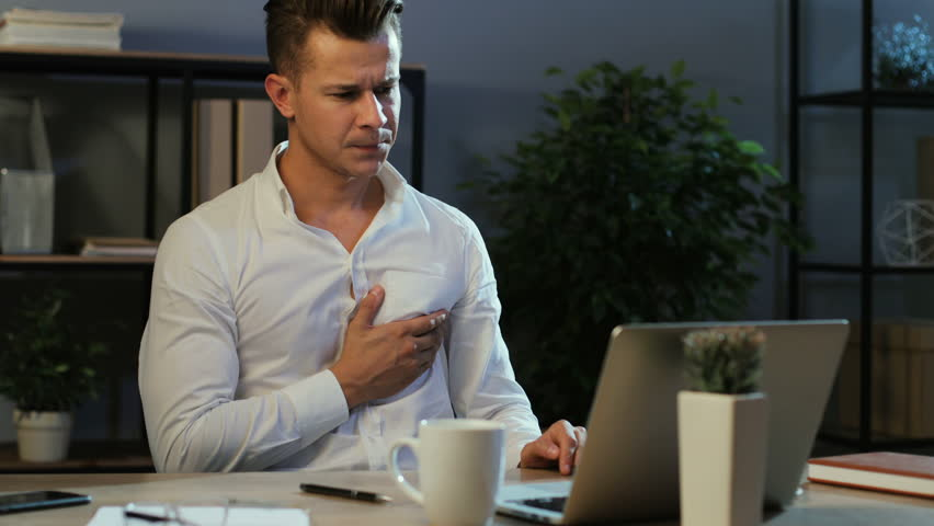 Attractive young business man in classic shirt try working with anoying head ache in the laptop in the stylish office at the evening. | Shutterstock HD Video #29706838