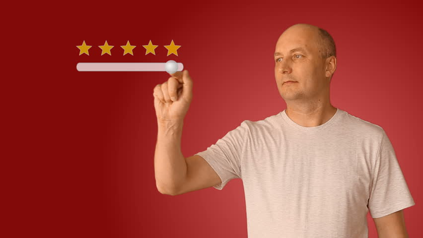 Feedback five stars from man on virtual screen. Young man move slider to set rating of services from one to five star. Caucasian man smiling and show thumbs up.