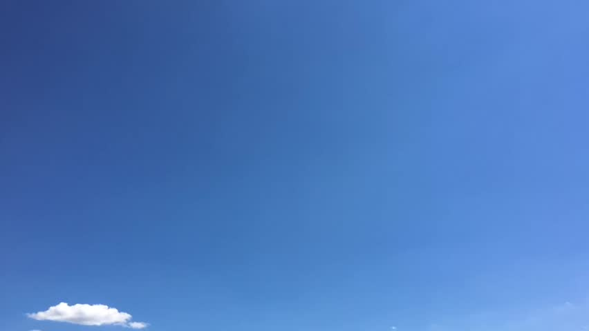 White clouds disappear in the hot sun on blue sky. Time-lapse motion clouds blue sky background. Blue sky. Clouds. Blue sky with white clouds.