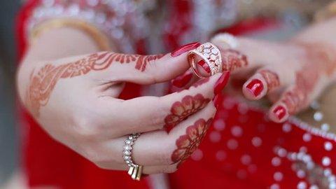 Lahore , Pakistan , December 15, 2016 : beautiful bride wearing her ring close up view