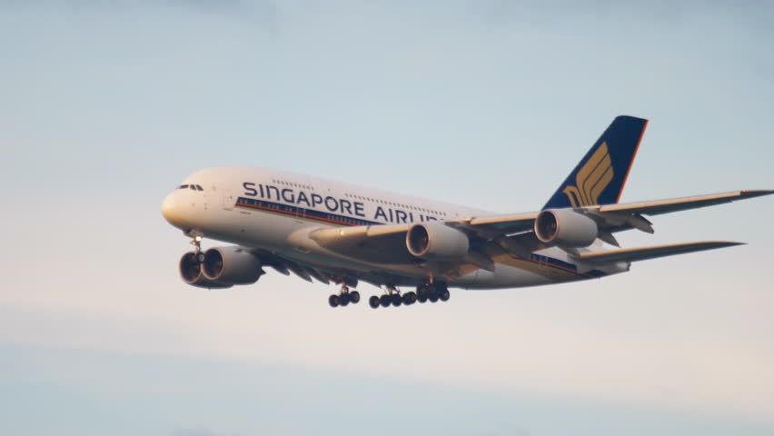 FRANKFURT AM MAIN, GERMANY - JULY 17, 2017: Singapore Airlines Airbus 380 9V-SKL approaching before landing. Sunrise light. Fraport, Frankfurt, Germany