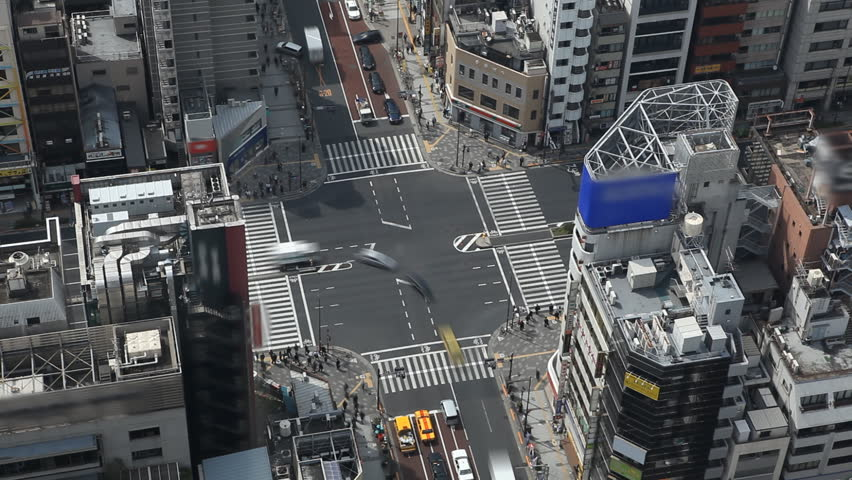 Aerial View of Tokyo Intersection, Japan, Commute, Crossroad, Metropolitan Area, time lapse, Blurred Logos
