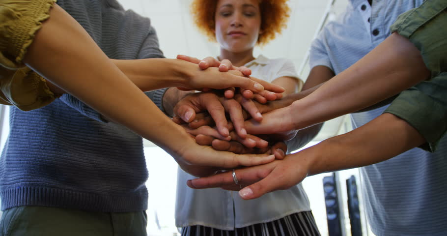 Team of business people forming hand stack in office #29763820