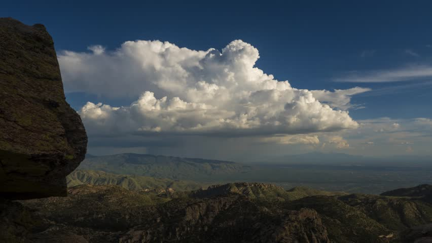 Time lapse of a monsoon thunderstorm beyond a large rock hoodoo