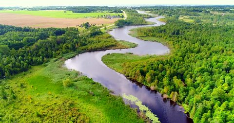 Aerial view of tranquil winding river amid lush green landscape, aerial view.