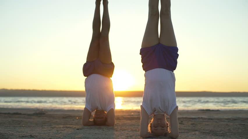 People support headstand yoga pose salamba sirshasanasunrise rapid slow motion    Shutterstock HD Video #29777266
