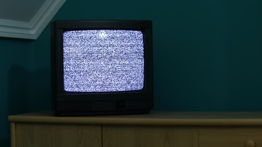 Snow noise on a small TV in a dim room