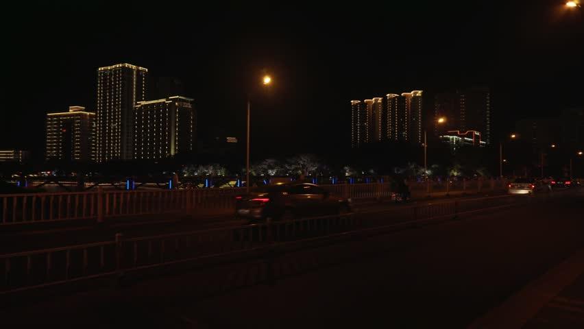 Sanya, China - April 03, 2017: Night illumination in the center of the tourist city of Sanya stock footage video