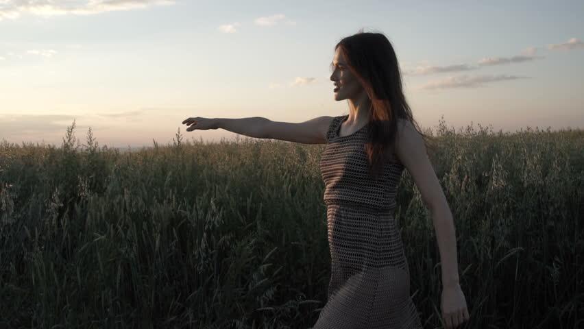 Sensual model posing on field   Shutterstock HD Video #29872678
