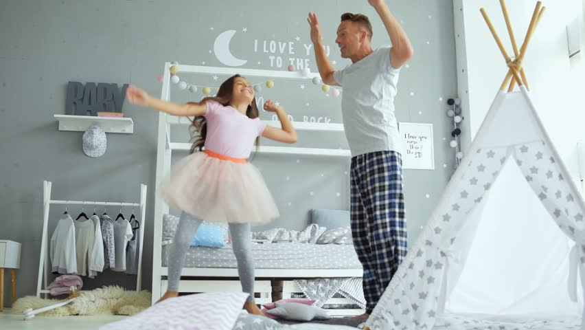 Joyful father and his little daughter dancing at home | Shutterstock HD Video #29882356