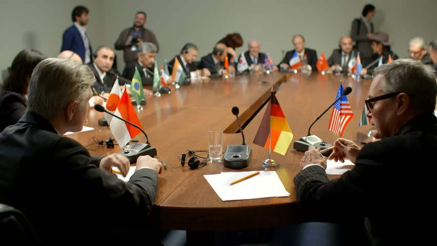 Shot of German flag. The international Commission at the round table. Participants of group of G20 applaud the representative of Germany