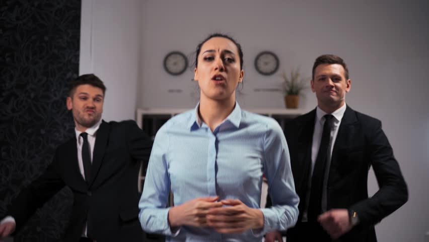 Three joyful businesspeople businesswoman and two businesman dancing cheerfully in office. We happy of friday ending! in 4k Ultra hd resolution. #29891059