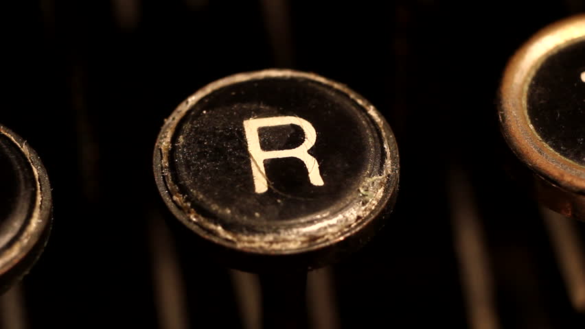 A male finger presses the letter