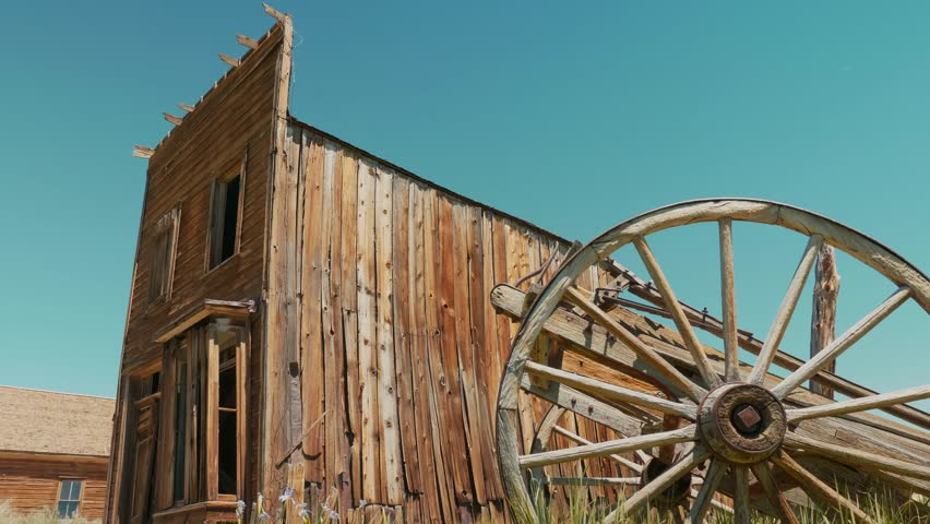 Bodie ghost town video, an abandoned countryside, decay gold wild west wooden buildings and cart, Bodie State Historic Park, California USA