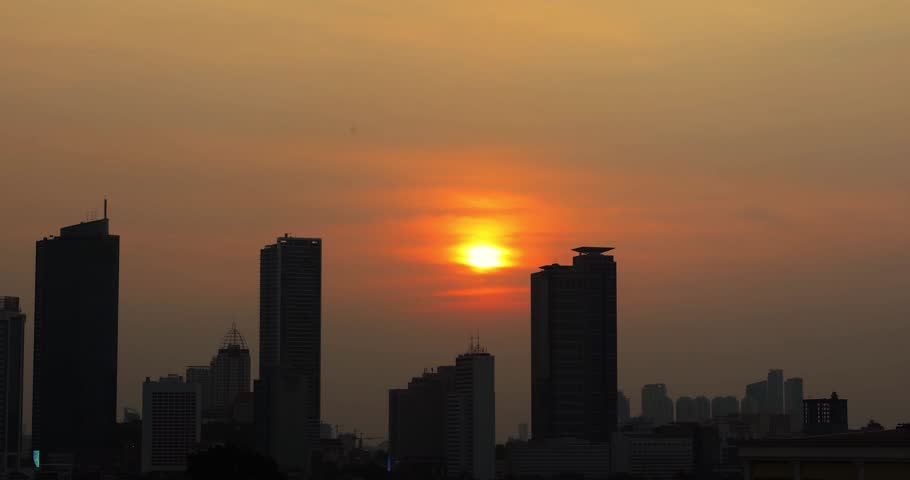 Time lapse footage of beautiful Jakarta city scenery with silhouette of skyscrapers at sunset time. Shot in 4k resolution | Shutterstock HD Video #29912686
