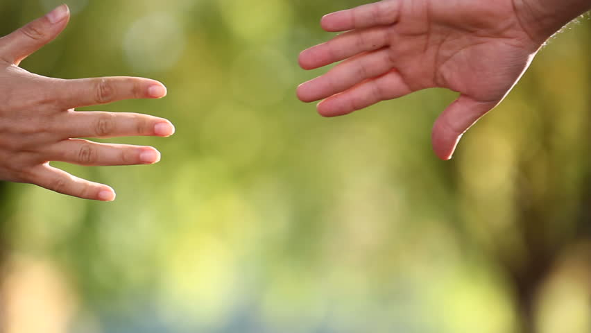 Detail of two lovers joining hands | Shutterstock HD Video #2993143