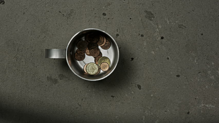 Beggar's mug being filled with coins and dollar | Shutterstock HD Video #29942965