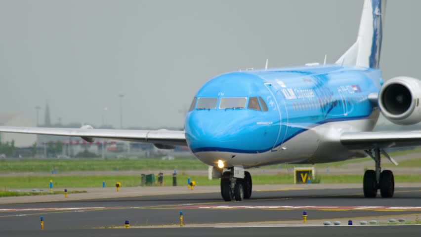AMSTERDAM, THE NETHERLANDS - JULY 25, 2017: KLM Cityhopper Fokker 70 PH-KZU Anthony Fokker Livery taxiing before departure at runway 36L Polderbaan. Shiphol Airport, Amsterdam, Holland | Shutterstock HD Video #29950003