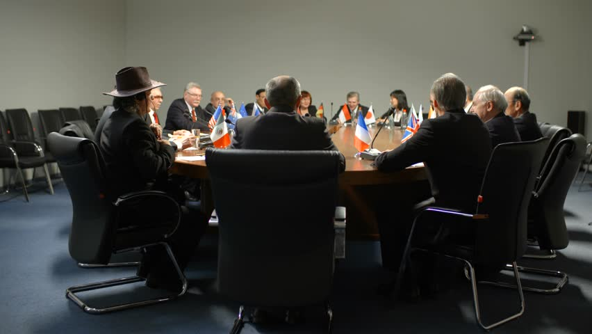Representatives or delegates from different countries vote for new law at the round table during an important political debates   Shutterstock HD Video #29955508