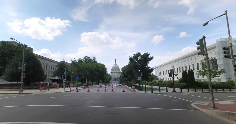 A forward perspective driving on East Capitol Street headed to the Capitol Building in Washington DC.