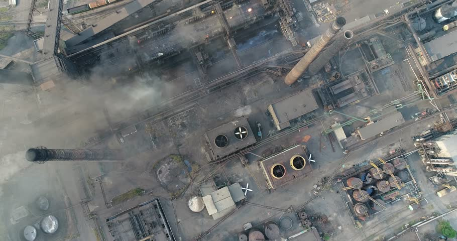 Industrial area top view, View of the industrial object, Courtyard of a factory, Aerial view, Smoke and fire, environmental pollution, environmental pollution, ecological disaster, panoramic view