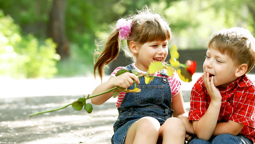 Two child speaking and boy present flower | Shutterstock HD Video #2996998