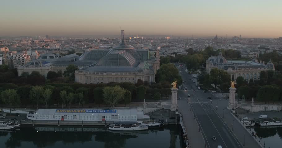 Aerial view of Alexandre III bridge, the Seine and the Grand Palais at sunrise, 4K Vue aérienne du Pont Alexandre III, de la Seine et du Grand Palais au petit matin, 4K | Shutterstock HD Video #29981848