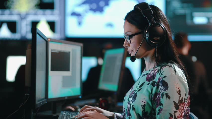 Attractive woman customer support phone operator at workplace