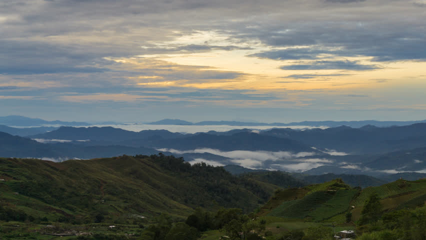 Beautiful View Of Fast Rolling Clouds Drifting Over Crocker Range. Soft Focus,Timelapse. Sabah, Malaysia. Tilt Up motion Time lapse.