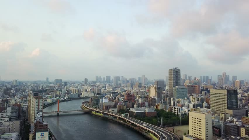 Aerial : Drone shooting of the landscape in Tokyo city Japan backward view the river and the bridge and roadway   Shutterstock HD Video #30014524