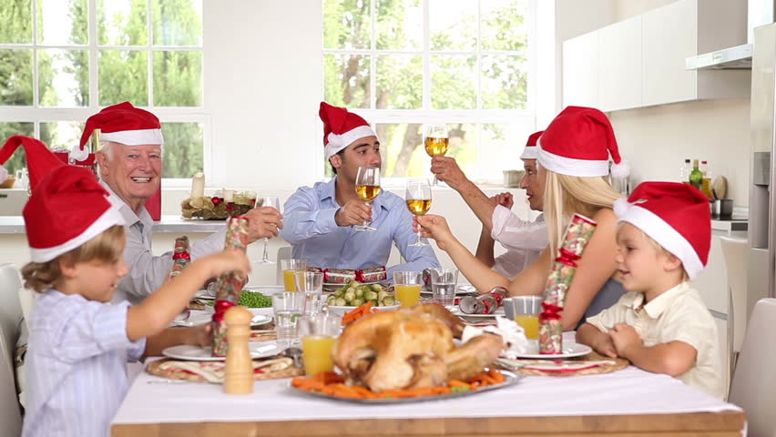 Happy family celebrating christmas at the dinner table