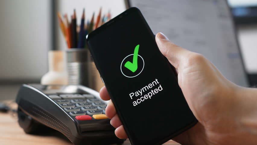 One male person pay in a trade with nfc system without contact in office. Close up shot man hold device with telephone app for banks payments use wireless. Process of transfering fund from cards Royalty-Free Stock Footage #30020725